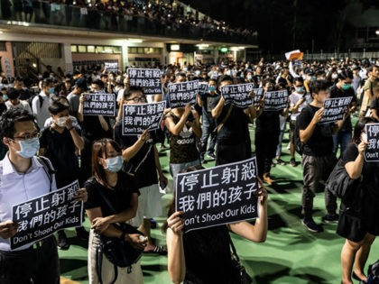 HONG KONG, CHINA - October 2: Pro-democracy protesters hold placards and sing songs as they gather in a park during a rally in Tuen Wan district on October 2, 2019 in Hong Kong, China. On October 1, pro-democracy protesters marked the 70th anniversary of the founding of the People's Republic …