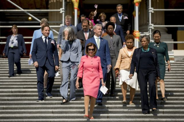 House Speaker Nancy Pelosi of Calif. and House Democrats arrive for a news conference on the first 200 days of the 116th Congress at the House east front steps on Capitol Hill, in Washington, Thursday, July 25, 2019. (AP Photo/Andrew Harnik)