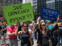 "NEW YORK, NY - JUNE 15: Protestors hold signs calling for the impeachment of U.S. President Donald Trump during a demonstration on June 15, 2019 in New York City. Major cities across the country are expected to hold ""#ImpeachTrump Day of Action"" protests on Saturday to demand that Congress begin …"