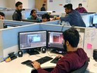 In this photo taken on January 10, 2019, employees of education technology start-up Byju's work on content development for the app at their office in Bangalore. - From a multi-billion-dollar education startup to wired-up mannequins, technology is helping to revolutionise the way Indian schoolchildren are learning -- provided their parents …