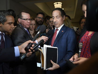 Rep. Jamie Raskin, D-Md., holds up documents as he talks with reporters on Capitol Hill in Washington, Wednesday, Oct. 2, 2019. Raskin talked with reporters after attending a closed-door briefing with the State Department Inspector General. (AP Photo/Susan Walsh)