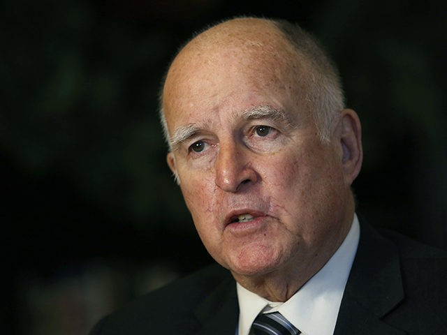 FILE - In this Dec. 18, 2018 file photo, then-California Gov. Jerry Brown discusses his time in the state's highest office during an interview with The Associated Press in Sacramento, Calif. Current and former governors, a U.S. senator and other notable figures are helping to create a new nonpartisan effort …