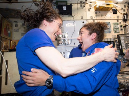 In this photo made available by NASA astronaut Jessica Meir on Sept. 29, 2019, Christina H. Koch, left, and Meir greet each other after Meir's arrival on the International Space Station. On Friday, Sept. 4, 2019, NASA announced that the International Space Station's two women will pair up for a …