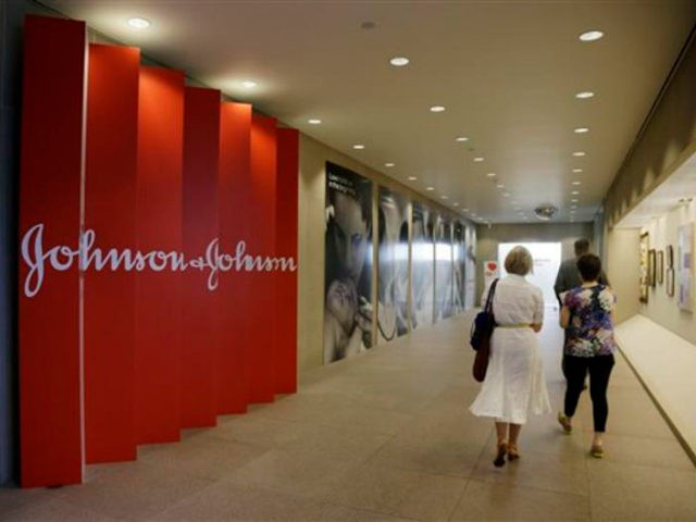 FILE - In this July 30, 2013, file photo, people walk along a corridor at the headquarters of Johnson & Johnson in New Brunswick, N.J. Amid the storm over soaring medicine prices, health care giant Johnson & Johnson says that beginning in February 2017 the company will disclose average increases …
