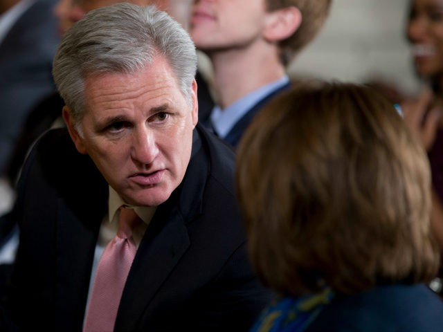 House Majority Leader Kevin McCarthy of Calif., left, talks with House Minority Leader Nancy Pelosi of Calif., right, before the start of a ceremony to honor the 2015 NBA Champion Golden State Warriors basketball team in the East Room of the White House, in Washington, Thursday, Feb. 4, 2016. (AP …