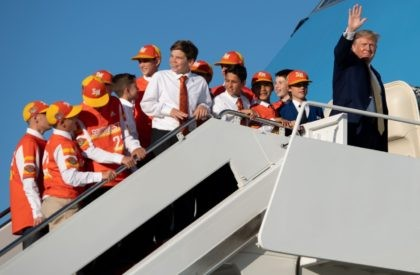US President Donald Trump boards Air Force One with members of the Little League World Championship baseball team, the Eastbank All Stars of Louisiana, prior to departure from Joint Base Andrews in Maryland, October 11, 2019, as he travels to Louisiana, to hold a campaign rally. (Photo by SAUL LOEB …