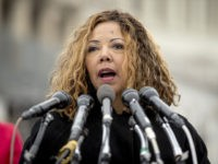FILE - In this Jan. 17, 2019 photo, Rep. Lucy McBath, D-Ga., speaks at a news conference on Capitol Hill in Washington. A spat over hours-long lines experienced by some Georgia voters bubbled up in Congress this week. Recent elections in Georgia were criticized during a hearing in Washington Tuesday. …