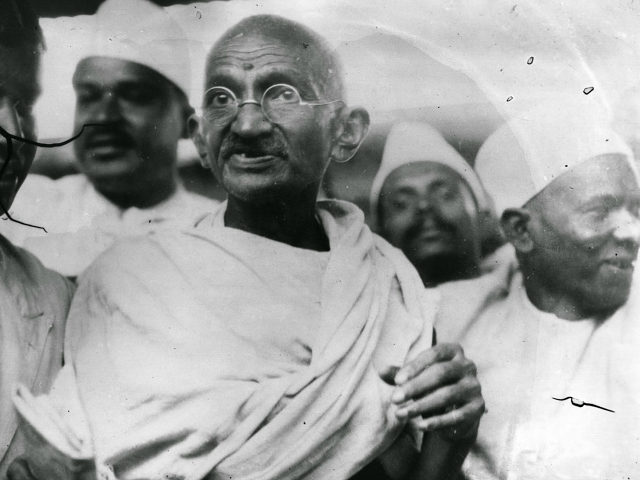 Mahatma Gandhi (Mohandas Karamchand Gandhi,1869 - 1948), Indian nationalist and spiritual leader, leading the Salt March in protest against the government monopoly on salt production. (Photo by Central Press/Getty Images)