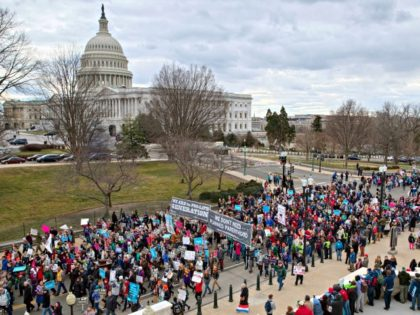 In this Friday, Jan. 27, 2017 file photo, anti-abortion demonstrators arrive on Capitol Hill in Washington during the March for Life, marking the anniversary of the 1973 Supreme Court decision legalizing abortion. Organizers say Donald Trump will become the first sitting president to address the 2018 March for Life gathering, …