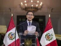 In this photo provided by the Peruvian presidential press office, Peru's President Martin Vizcarra delivers a national message from the government palace in Lima, Peru, Monday, Sept. 30, 2019. Vizcarra announced he had dissolved his nation's opposition-controlled congress amid a bitter feud over his fight to curb corruption. (Andres Valle/Peruvian …