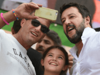 Supporters take a selfie photo with Italian senator, head of the Italian far-right League (Lega) party Matteo Salvini (R) on stage after he delivered a speech at the party's annual rally in Pontida on September 15, 2019. (Photo by Miguel MEDINA / AFP) (Photo credit should read MIGUEL MEDINA/AFP/Getty Images)