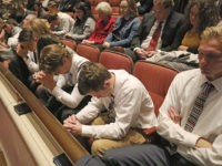People pray during The Church of Jesus Christ of Latter-day Saints' twice-annual church conference Saturday, Oct. 5, 2019, in Salt Lake City. President Russell M. Nelson has rolled out a dizzying number of policy changes during his first two years at the helm of the faith, leading to heightened anticipation …