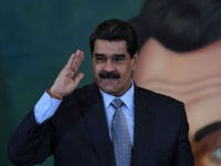 TOPSHOT - Venezuelan President Nicolas Maduro salutes after a press conference in Caracas on September 30, 2019. - Virtually all countries sent diplomats to the United Nations for the General Assembly last week, but Venezuela was a special case -- it had two delegations, each dueling for recognition. (Photo by …