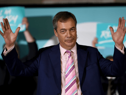 CAMBORNE, ENGLAND - OCTOBER 14: Leader of the Brexit Party, Nigel Farage addresses the audience at The Brexit Party rally at Carn Brea Leisure Centre, on October 14, 2019 in Camborne, England. The Brexit Party rally is part of a nationwide 'We Are Ready' tour ahead of a General Election. …
