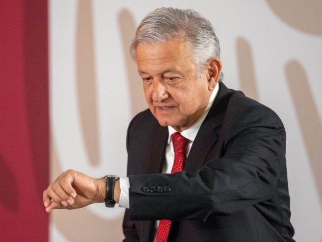 Obrador checks watch (Pedro Pardo / AFP / Getty)