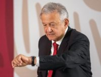 Obrador checks watch (Pedro Pardo / AFP / Getty)