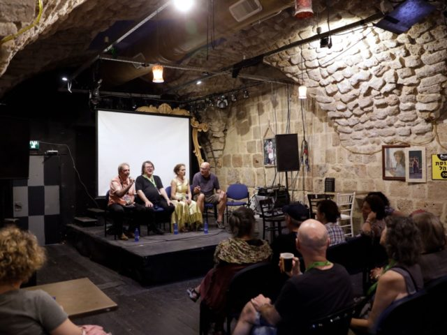 Israeli artist Oded Kotler (on stage 2 L), the founder of the Akko (Acre in Hebrew) Fringe Theatre Festival takes part in a discussion panel during the festival in Acre on October 16, 2019. - Kotler, who won the award for Best Actor at the 1967 Cannes Film Festival for …