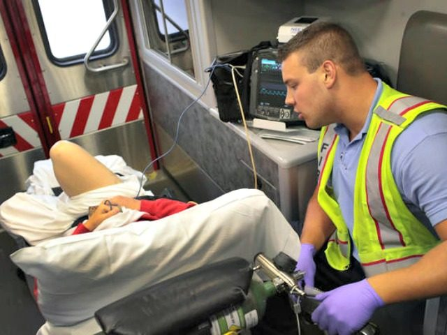 An Illinois firefighter treats an overdose victim as she is transported to a hospital.