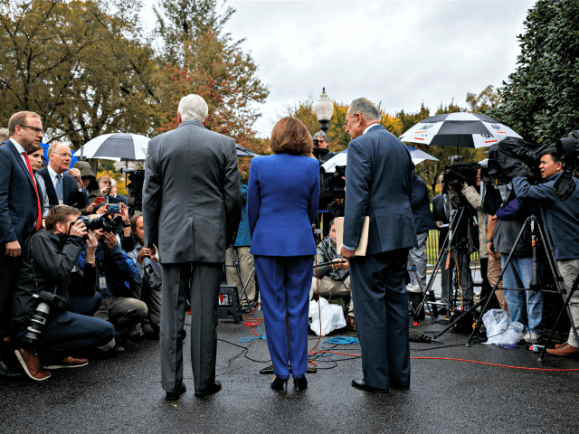 Speaker of the House Nancy Pelosi of Calif., center, Senate Minority Leader Sen. Chuck Schumer of N.Y., right, and House Majority Leader Steny Hoyer of Md., talk with reporters following a meeting with President Donald Trump at the White House, Wednesday, Oct. 16, 2019, in Washington. (AP Photo/Evan Vucci)