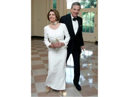 House Democratic Leader Nancy Pelosi, D-Calif., and her husband Paul Pelosi arrive for a State Dinner hosted by President Barack Obama and first lady Michelle Obama in honor of German Chancellor Angela Merkel at the White House in Washington, Tuesday, June 7, 2011. (House Democratic Leader Nancy Pelosi, D-Calif., and …