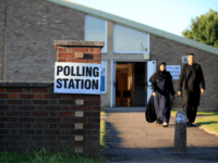 Constituents arrive to cast their votes at the Christ the Carpenter church Hall in Peterborough, England on June 6, 2019. - A local by-election was triggered when Peterborough's former MP Fiona Onasanya was sacked by her constituents in the first successful re-call petition prompting a by-election. (Photo by Lindsey Parnaby …