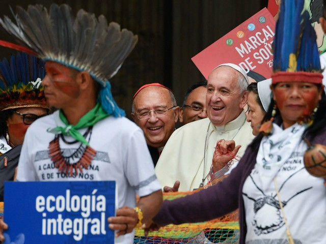 Representatives of the Amazon Rainforest's ethnic groups, Catholic prelates, Peruvian Cardinal Pedro Ricardo Barreto (Rear C) and Pope Francis (C-R) march in procession during the opening of the Special Assembly of the Synod of Bishops for the Pan-Amazon Region on October 7, 2019 outside St. Peter's Basilica in the Vatican. - Pope Francis is gathering Catholic bishops at the Vatican to champion the isolated and poverty-struck indigenous communities of the Amazon, whose way of life is under threat. (Photo by Andreas SOLARO / AFP)