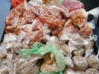CBP agriculture specialists and officers intercepted plastic bags containing 66 pounds of pork, 33 pounds of raw poultry and a personal use quantity of heroin during an examination of a passenger vehicle at Juarez- Lincoln Bridge. (Photo: U.S. Customs and Border Protection/Laredo Sector)