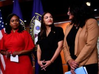 US Representatives Ayanna Pressley (D-MA) (L), Rashida Tlaib (D-MI) (R), and Alexandria Ocasio-Cortez (D-NY) look on during a press conference, to address remarks made by US President Donald Trump earlier in the day, at the US Capitol in Washington, DC on July 15, 2019. - President Donald Trump stepped up …