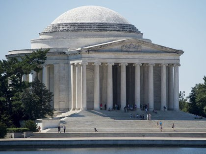 A black substance known as biofilm, a group of bacteria, fungi and algae, covers the Jefferson Memorial in Washington, DC, August 23, 2016, as the National Park Service works to find a safe way to remove the substance from the Memorial's marble exterior. / AFP / SAUL LOEB (Photo credit …
