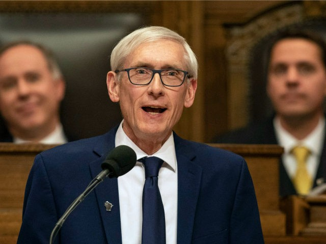 In this Jan. 22, 2019, file photo Wisconsin Gov. Tony Evers addresses a joint session of the Legislature in the Assembly chambers during the Governor's State of the State speech at the state Capitol in Madison, Wis. The Democratic Governor says a judge should suspend Republicans' lame duck law limiting …