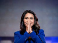 Democratic presidential candidate Rep. Tulsi Gabbard (R-HI) addresses the crowd during the 2019 South Carolina Democratic Party State Convention on June 22, 2019 in Columbia, South Carolina. Democratic presidential hopefuls are converging on South Carolina this weekend for a host of events where the candidates can directly address an important …