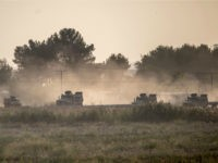 Turkish army vehicles drive towards the Syrian border near Akcakale in Sanliurfa province on October 9, 2019. - Turkey launched an assault on Kurdish forces in northern Syria on October 9 with air strikes and artillery fire reported along the border. The Turkish President announced the start of the attack …