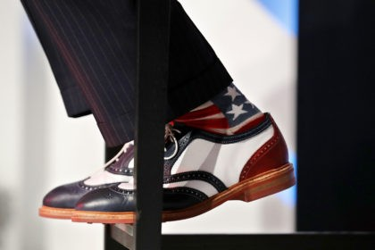 WASHINGTON, DC - SEPTEMBER 09: Former New York City Mayor Rudy Giuliani wears red, white and blue socks and shoes as he addresses the Values Voter Summit at the Omni Shoreham September 9, 2016 in Washington, DC. Hosted by the Family Research Council, the summit is an annual gathering of …
