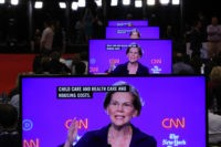 WESTERVILLE, OHIO - OCTOBER 15: Sen. Elizabeth Warren (D-MA) appear on television screens in the Media Center during the Democratic Presidential Debate at Otterbein University on October 15, 2019 in Westerville, Ohio. A record 12 presidential hopefuls are participating in the debate hosted by CNN and The New York Times. …