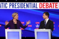 WESTERVILLE, OHIO - OCTOBER 15: Sen. Elizabeth Warren (D-MA) speaks to South Bend, Indiana Mayor Pete Buttigieg during the Democratic Presidential Debate at Otterbein University on October 15, 2019 in Westerville, Ohio. A record 12 presidential hopefuls are participating in the debate hosted by CNN and The New York Times. …