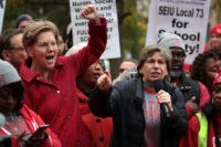 CHICAGO, ILLINOIS - OCTOBER 22: Democratic presidential candidate Sen. Elizabeth Warren (D-MA) (L) and American Federation of Teachers (AFT) president Randi Weingarten visit with striking Chicago teachers at Oscar DePriest Elementary School on October 22, 2019 in Chicago, Illinois. About 25,000 Chicago school teachers went on strike last week after …