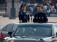 BEIJING, CHINA - OCTOBER 01: Chinese President Xi Jinping drives in a Hong Qi car after inspecting the troops during a parade to celebrate the 70th Anniversary of the founding of the People's Republic of China at Tiananmen Square in 1949, on October 1, 2019 in Beijing, China. (Photo by …