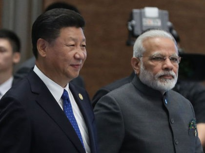 (L to R) Chinese President Xi Jinping and Indian Prime Minister Narendra Modi attend the Dialogue of Emerging Market and Developing Countries on the sidelines of the 2017 BRICS Summit in Xiamen, southeastern China's Fujian Province on September 5, 2017.