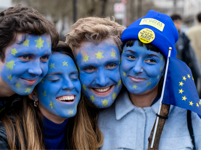 TOPSHOT - People with their faces painted in European flag colours attend a rally organised by the pro-European People's Vote campaign for a second EU referendum in Parliament Square, central London on March 23, 2019. - Hundreds of thousands of pro-Europeans from across Britain were expected to march through London …