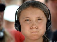 Swedish climate activist Greta Thunberg reacts as she listens to her headphones before the 2019 Normandy 'Freedom prize' award ceremony on July 21, 2019 in Caen, Western France. (Photo by Jean-Francois MONIER / AFP) (Photo credit should read JEAN-FRANCOIS MONIER/AFP/Getty Images)