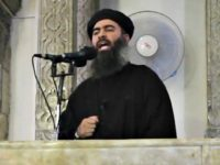 This file image made from video posted on a militant website July 5, 2014, which has been authenticated based on its contents and other AP reporting, purports to show the leader of the Islamic State group, Abu Bakr al-Baghdadi, delivering a sermon at a mosque in Iraq. (Militant video/AP)