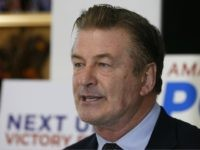 Actor Alec Baldwin, speaks to supporters of Amanda Pohl, candidate for Virginia Senate District 11 in her home in Midlothian, Va., Tuesday, Oct. 22, 2019. Baldwin campaigned for several candidates around the state. (AP Photo/Steve Helber)