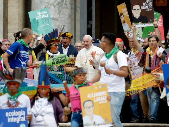 Pope Francis walks in procession on the occasion of the Amazon synod, at the Vatican, Monday, Oct. 7, 2019. Pope Francis opened a three-week meeting on preserving the rainforest and ministering to its native people as he fended off attacks from conservatives who are opposed to his ecological agenda. (AP …