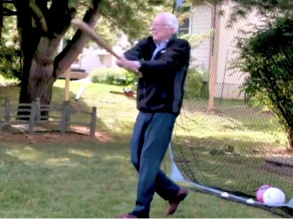 bernie swings a bat