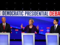 Former Vice President Joe Biden, Sen. Elizabeth Warren (D-MA) and South Bend, Indiana Mayor Pete Buttigieg during the Democratic Presidential Debate at Otterbein University on October 15, 2019 in Westerville, Ohio. A record 12 presidential hopefuls are participating in the debate hosted by CNN and The New York Times. (Photo …