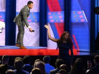A transgendered woman audience member gives the microphone back to moderator Don Lemon during a town hall devoted to LGBTQ issues hosted by CNN and the Human rights Campaign Foundation at The Novo in Los Angeles on October 10, 2019. (Photo by Robyn Beck / AFP) (Photo by ROBYN BECK/AFP …