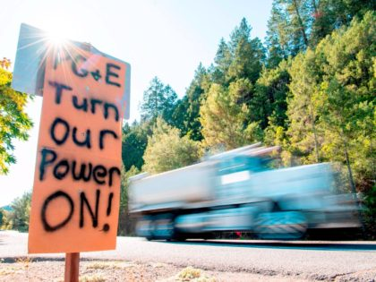 A sign calling for PG&E to turn the power back on is seen on the side of the road during a statewide blackout in Calistoga, California, on October, 10, 2019 - Rolling blackouts set to affect millions of Californians began October 9, as Pacific Gas & Electric started switching off …