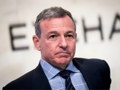 NEW YORK, NY - NOVEMBER 27: Chief executive officer and chairman of The Walt Disney Company Bob Iger walks on the floor of the New York Stock Exchange (NYSE) before ringing the opening bell, November 27, 2017 in New York City. Disney is marking the company's 60th anniversary as a …