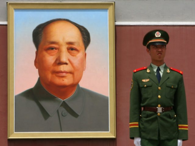 A Chinese paramilitary soldier stands guards in front of a new giant portrait of former Chinese leader Mao Zedong on display at Tiananmen Square in Beijing, 13 May 2007. Police 12 May detained an unemployed man who tried to set fire to the famed giant portrait of Chinese revolutionary leader …
