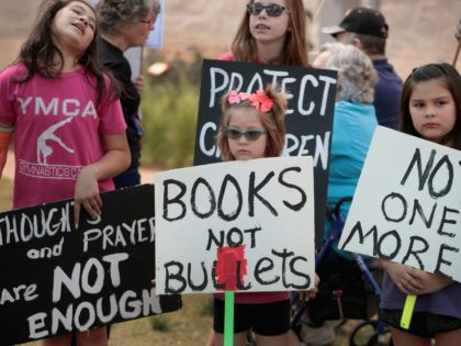 ROUND ROCK, TX - MARCH 24: Children participate in a March for Our Lives rally on March 24, 2018 in Round Rock, Texas. More than 800 March for Our Lives events, organized by survivors of the Parkland, Florida school shooting on February 14 that left 17 dead, are taking place …